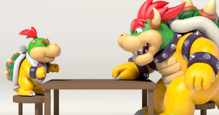Bowser sitting at the table opposite Bowser Jr., his son, showing he is a good parent.