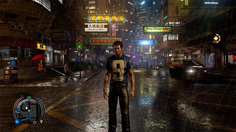 Sleeping Dogs showing a rainy street in Hong Kong with a man standing in the rain.