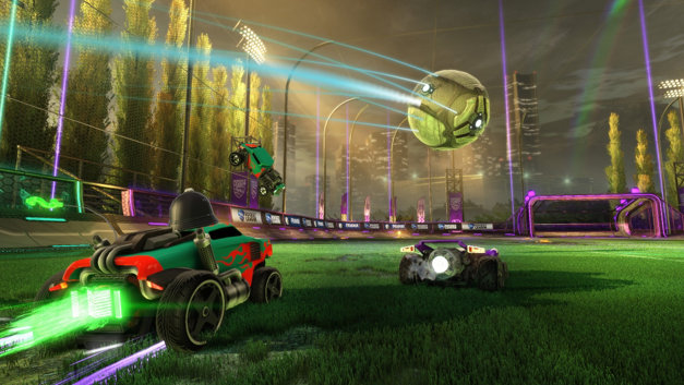 Rocket League showing two remote controlled cars chasing a football while another swoops in.