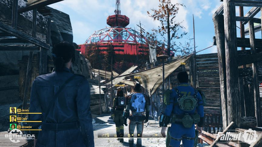 4 people walking into an amusement park in Fallout 76.